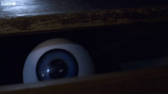 A horrible disembodied eye in a desk drawer