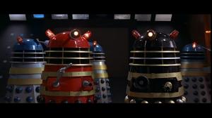 Several multicoloured Daleks