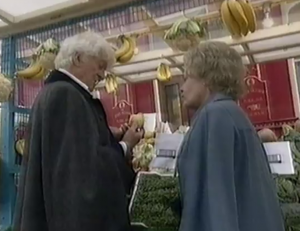 The third Doctor and Pauline Fowler in the distant future of 2013