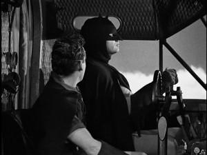 Batman piloting a plane