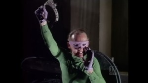 The Riddler holds up a coronet, taunting Batman & Robin